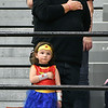 "Four year-old ""Wonder Woman"" Lucy Hale salutes the American flag with her hand over her heart just like her father, Paul Hale of Daleville, during the playing of the National Anthem before the Anderson University volleyball match against Manchester Wednesday evening. It was senior night and they came to watch their cousin, Emily Hale, play her last home game as a senior."