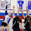 Elwood's Jaleigh Crawford powers the ball over the net for a kill.