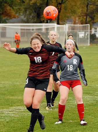 Emily Buchman keeps the ball away from Rose-Hulman players by knocking it out of bounds.