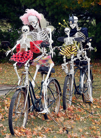 Lloyd and Gail Shinholt with their large Halloween skeleton display.