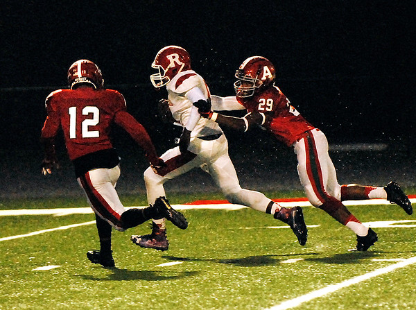 Anderson linebacker Israel Dates tackles Richmond runner William McGaffey as teammate Joseph Jones moves in to assist.