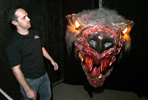 Jon Pianki, marketing director for Indy Scream Park, checks out one of the animatronic props in the new Nightmare Factory attraction at Indy Scream Park.
