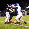 Chris Martin for The Herald Bulletin.  Lapel's Brice Everitt gets a tackle deep into Eastern Hancock's backfield Friday night at home.