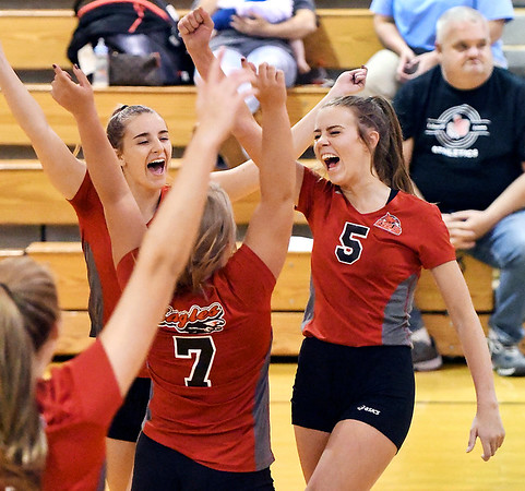 Frankton's Kate Sperry, right, celebrates with her teammates after getting her 1,000th kill in her high school career Tuesday evening against Liberty Christian.