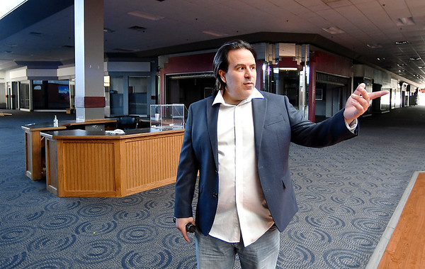 Mark Squillante, new owner of the Mounds Mall building, points out issues that need to be addressed before the structure can be renovated and reopened.