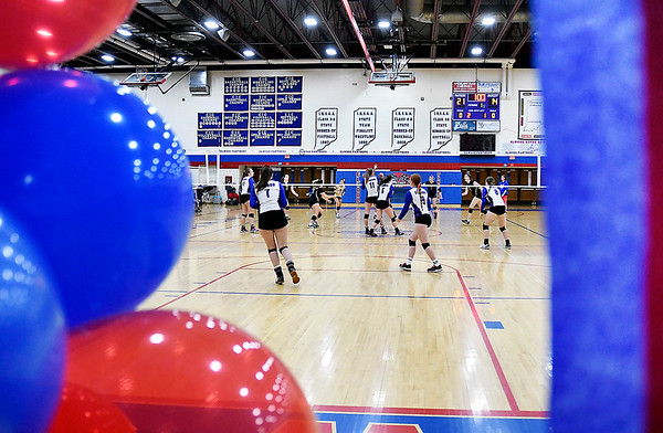 The Elwood High School gym was decked out with red and blue balloons and streamers as the school honored their six senior volleyball players on their last home match of the season.