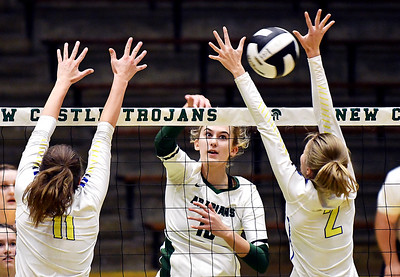 Pendleton's Gracie King attempts a kill against Ava Antic and Molly Schwarzkopf of Greenfield-Central.