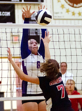 Elwood's Kelsey Ruder makes a block during Thursday nights sectionals.