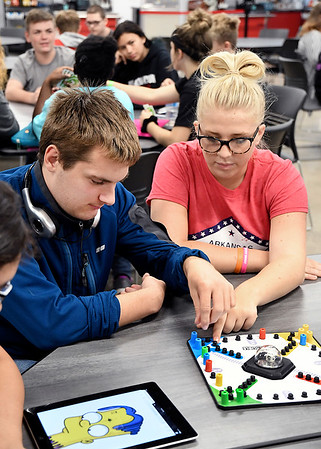 Jeremy Hicks, senior, and his best buddy, Sophia Chaplin, junior, play a game during the Frankton High School's Best Buddies program gathering recently.