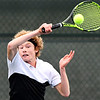 Jesse McCurdy, of Lapel, follows through on his forehand shot during his IHSAA Singles State Finals quarterfinal match against Daniel Pries of South Bend St. Joseph.