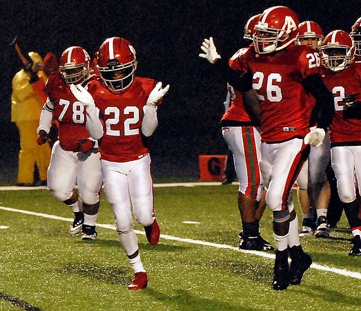 Willie Dennison claps his hands after scoring a touchdown for the Anderson Indians. To his left is teammate Christopher McKeller.