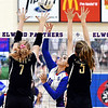 Elwood's Morgan Scott, center, taps the over the outstretched arms of Madison-Grant's Grace Holmberg and Azmae Turner.