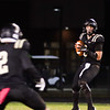 Chris Martin for The Herald Bulletin Lapel Quarterback Cole Alexander looks downfield Friday night at home against Eastern Hancock.