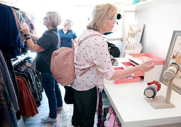From left, Lori Lord, Stacy Holtzleiter and Naomi Sandefur shop at Karla Montgomery's boutique on wheels, Sweet Threads, on Thursday.