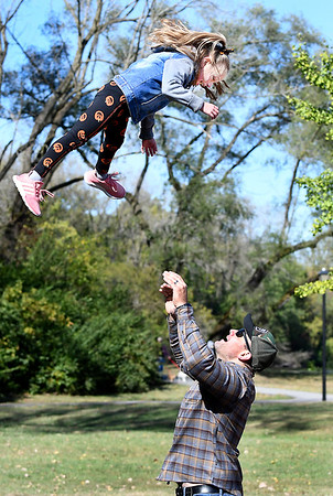 Zach Ward tosses his daughter, Holland, 6, high up in the air as they were playing at Shadyside Park Saturday afternoon. The Wards are from Brownsburg and were in Anderson for a family birthday party held at the park.