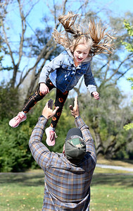 Holland Ward, 6, smiles as she comes down to her fathers arms after Zach Ward tossed her up high in the air while they played at Shadyside Park Saturday afternoon. The Wards are from Brownsburg and were in Anderson for a family birthday party held at the park.