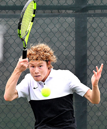 Jesse McCurdy, of Lapel, returns a forehand shot during his IHSAA Singles State Finals quarterfinal match against Daniel Pries of South Bend St. Joseph.