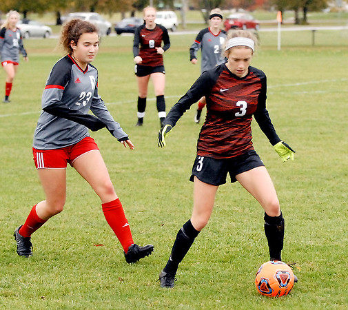 Jessica Pulaski keeps the ball away from Rose-Hulman player Veronica Gawarecki in Ravens' territory.
