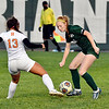 Katie Smith of  Hamilton Hts. and Pendleton's Macy Browning go after the ball to gain possession.