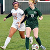 Pendleton's Macy Browning works the ball away from Hamilton Hts. defender, Katie Smith.