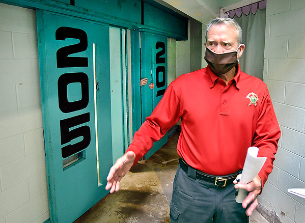 Madison County Sheriff Scott Mellinger shows some of the maximum security doors that are malfunctioning in this cell block of the jail. The door for cell 205 will only close half way and cell 207 will not close tightly leaving a large gap where inmates can get their hands through.