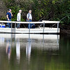 These anglers keep a watch on their lines for signs of any activity as they do a little pier fishing on the north end of Shadyside Lake Wednesday afternoon.