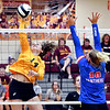Alexandria's Ashlynn Duckworth makes takes her shot as Elwood's Kendra Sallee defends the net for one of her 10 kills for the match.