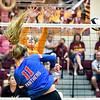 Elwood's Jaleigh Crawford's hair flies as she spikes the ball as Alexandria's Ashlynn Duckworth tries to block.