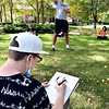 Anderson University freshman Nita Mabbett, from Anderson, sketches body forms as model Brandyn Barrett strikes different poses during professor Holly Sims Into to Drawing class as they hold class outside in the valley on a beautiful Thursday afternoon.