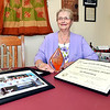 Jan Bronnenberg, recipient of The Golden Hoosier Award, is shown here with her State award and photo of her in the Nursing Honor Guard.