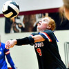 Elwood's Kaylee Guillemette eyes the ball as she volleys to her teammate.
