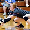 Elwood's Kaylee Guillemette goes low to dig the ball out to keep the volley going.