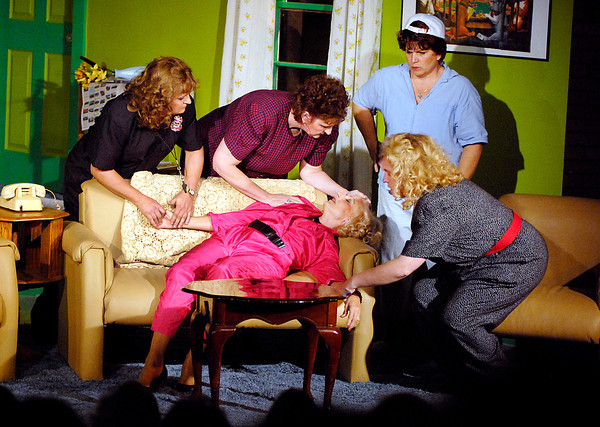 """Women in """"The Female Odd Couple"""" try to revive a friend, played by Connie Rich, in the Anderson's Mainstage Theatre production that runs this weekend and next.  The performers, standing from left, are Theresa Timmons, Kaye Koomler and Katherine Holtzleiter.  Sitting is Melissa Spencer."""