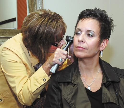 Sunday biz profile_Kathy Sizelive opened hearing aid store.