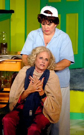 """Florence (Connie Rich) gets a neck rub from Olive (Katherine Holtzleiter) to help her relax in the production of """"The Female Odd Couple"""" at the Mainstage Theatre."""