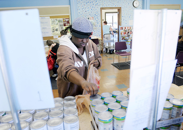 Frances Cooper picks out canned goods at the Park Place Community Center Food Pantry on  Wednesday.