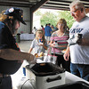 Hotdogs were the main course at the Madison County Solidarity Labor Day Picnic Monday where Denny Cheshier was dishing up coney sauce for the dogs.
