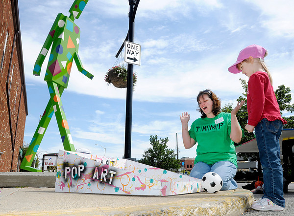 Makena Hunger, 5, plays Pop Art Tic Tac Toe during the Walking Manifestival downtown on Saturday.
