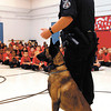 APA elementary students raised over $1700 for the Anderson Police Department K-9 program.  APD K-9 officer Darron Granger, with dog Truman, talked to the students Tuesday.