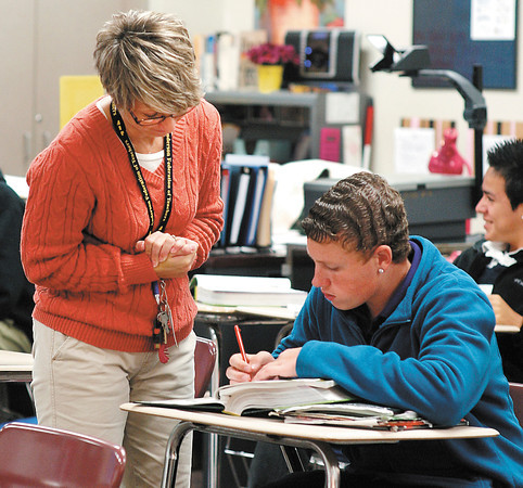 8th grade English teacher Tammy Kennedy works with student James Allendar in her class in the Success Academy at Highland Middle School.
