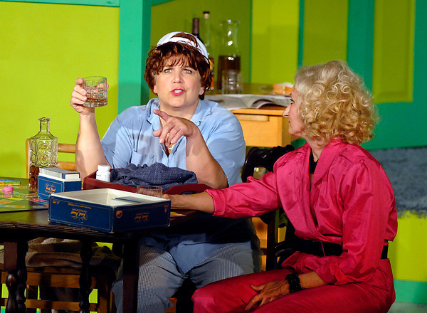 "Olive (Katherine Holtzleiter) and Florence (Connie Rich) have a brandy in the production of ""The Female Odd Couple"" at the Mainstage Theatre."