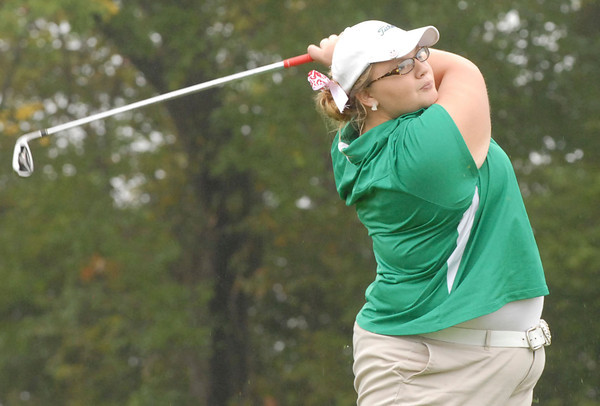Morgan Nadaline watches a fairway shot land safely on the green.