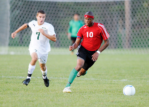 Anderson's Marc Andrews controls the ball as he is pressured by Pendleton Heights' Nathan Petry as the Arabians hosted the Indians on Wednesday.