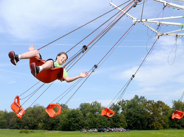 Zachary Hall, 11, from Muncie rides in a swing during Frankton Heritage Days on Saturday.