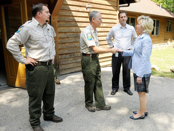 Lt. Governor Becky Skillman greets Mounds Property Manager Ted Tapp as she arrives at the park during her Hoosier Crossroads Tour on Thursday. Also pictured are Assistant Property Manager of Mounds and Fort Harrison Dustin Clark at left and DNR North Region Manager Carl Lindell.