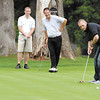 Nick Holton, JP Bryan, and Mark Beneke watch as teammate Shane Schuh attempts his birdie putt on the 18th green during the Second Harvest Foodbank fundraiser golf tournament held at Anderson Country Club Monday afternoon.  They had 28 teams for the event.