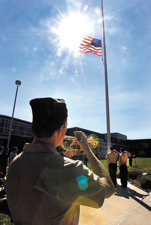 ROTC cadet Ensign Collin Pratt plays taps during a 9/11 ceremony at Anderson High School put on by the ROTC unit of the school as the American flag flew at half-staff in honor of those who died in the 9/11 terrorist attacks.