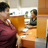 Constance Boards processes a transaction for Rose Harrington at the new Madison County Federal Credit Union location on Nichol Avenue in Edgewood on Friday. The branch celebrated their grand opening on Friday.