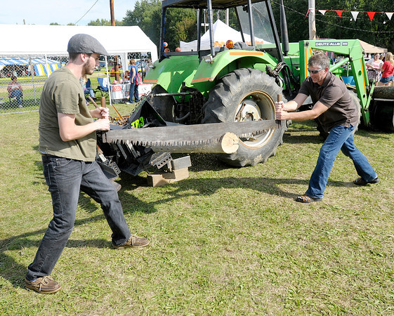 From left Eli Knotts and his father Dave take a practice run during the cross cut saw competition at Frankton Heritage Days on Saturday.