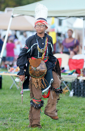 A dancer participates in the Andersontown Powwow at Athletic Park on Saturday. The Powwow continues today.